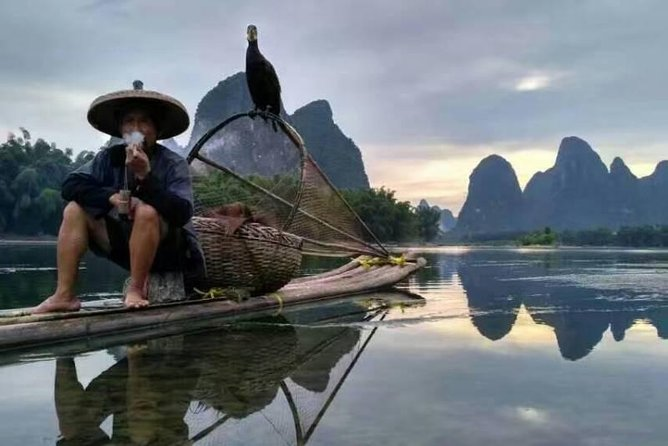This is a professional photographers' one day tour in Guilin and Yangshuo area. Our skillful guide will present his clients the best Li river photo shot point, most classic rurality with traditional farmer and buffalo, and most poetic definition of harmony between nature and human with the fishman and his cormorant birds on the bamboo raft in Li river