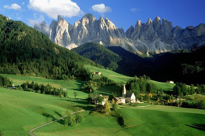 Escape the city and spend a day in the Dolomite Mountains on a full-day trip from Venice! With an expert driver-guide to tell you all about the region, you'll see one of the area's finest lake, Lake Misurina, headed up by the heart-stopping Tre Cime di Lavaredo peaks. Enjoy lunch in a traditional 'trattoria' (own expense), soak up the scenery on a bracing mountain walk, and then enjoy free time to explore the chic ski resort town of Cortina d'Ampezzo. <br><br> From November 15th until the Tre Cime di Lavaredo re-opens ( generally the third week of May), join the Dolomites Day tour from Venice to visit Cortina, the picturesque Braies Lake and San Candido,one of the most beautiful South Tyrolean villages in the Dolomites. <br><br>Numbers are limited to 8 on this small-group tour, ensuring you'll see the best of the Dolomites with personalized attention from your driver-tour escort.