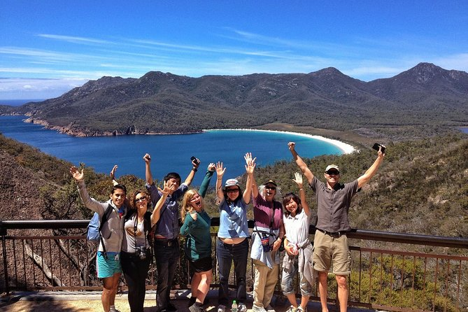 "Walk to the Wineglass Bay lookout to see one of the ""World's Top 10 beaches!"" Join us for this action-packed huge day out exploring the very best of Tasmania's East Coast. We enjoy a variety of short walks, National Park coastal scenery & delicious local food opportunities along the way (local oysters, berries, ice-creams and hand-made chocolates!)<br><br>Highlights<br>• Explore Freycinet National Park (4+ hours)<br>• Walk to the spectacular Wineglass Bay Lookout (moderate uphill walk 45 mins)<br>• Choose the option to extend your walk to the white sands of Wineglass Bay (longer walking option 2.5 hours)<br>• Visit the highlights of Freycinet National Park - Honeymoon Bay & Sleepy Bay<br>• Take in the spectacular 360 degree views on the Cape Tourville Lighthouse Walk (easy 20 mins)<br>• Enjoy some fresh oysters at Freycinet Marine Farm <br>• Reward yourself with a tasty ice-cream at Kate's Berry Farm – delicious!<br>• Check out the unusual convict built Spiky Bridge<br>"