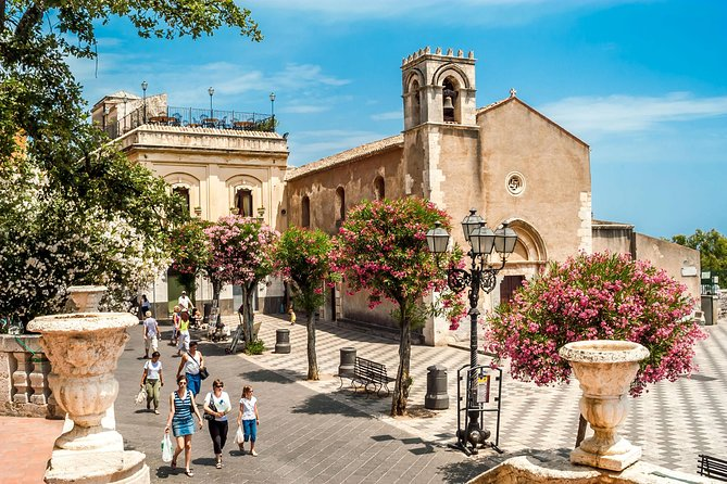 Enjoy this 5-hour private guided tour to the most important Sicilian resorts: Taormina, Castelmola, and Giardini Naxos. A guide will lead your group to explore amazing places such as the main street Corso Umberto, the Greek theater, Palazzo Corvaja, St. Catherina church, Odeon theater, Palazzo Duchi di St.Stefano, and Duomo. Opt to taste the superb Sicilian wines in the best wine restaurant with a seafront view in Giardini Naxos.<br>Important: when making a booking, please select a tour option in accordance with your pickup location (Taormina, Catania or Messina) and whether you would like to opt for food and wine tasting.