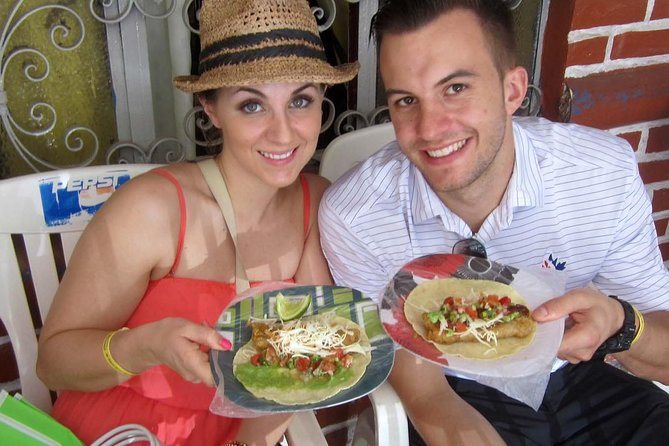 Our Signature Taco Tour is perfect for people who want to dive deeper into Mexican Culture and eat a wide variety of the everyday food the locals eat.<br><br>Enjoy a wonderful walking food tour showcasing the most delicious tacos and street food offered in the Bay of Banderas. Journey with a foodie guide and learn how the locals eat. Sample regional specialties including birria, carnitas, fish tacos, and many more dishes—plus dessert and candies. This 3.5-hour, small-group walking tour will open your eyes to the culture, food, and traditions of beautiful Puerto Vallarta. Bottled water, food and non-alcoholic drinks, a colorful signature shopping bag, and complimentary tour photos are all included. Arrive hungry!<br><br>The Signature Taco Tour is offered seven days per week. Please remember that it's for a maximum of six people and, as a result, sells out quickly. Don't wait, reserve your spot today.