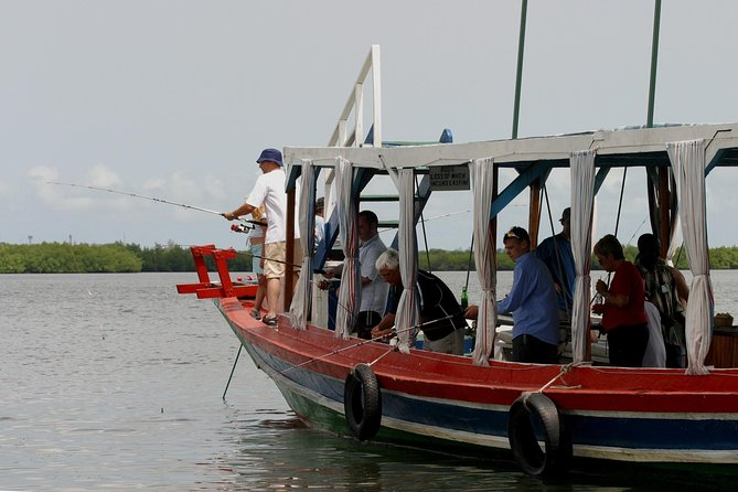 This a popular small group excursion cruising and fishing in the mangrove creeks and River Gambia, on board a traditional 60 foot African pirogue.<br><br>Staring out from your hotel in the morning, you will be taken to Denton Bridge to board your boat. Spend the day trolling to catch Barracuda or bottom fishing to catch Captain fish, Red snapper, Grouper, Cassava, Stingray, Guitar-fish and many more that can be likely catch of the day.<br><br>The spacious open deck boat is an ideal fishing platform and has a 30-foot shade so we can fish from the shade or in the sun, as we choose. We may sail with 4 or 8 crew members which depend on the size of the groups. <br><br>This is an ideal opportunity for the beginner or experience angler to enjoy catching sporting, tropical fish on light easy to use tackle with expert tuition.