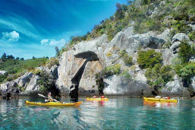Explore Lake Taupo as you kayak to the Maori Rock Carvings at Mine Bay. You will start your half day tour from the sheltered waters of Acacia Bay before paddling out on the lake below native bush, past steep cliffs and mini inlets that can only harbor a kayak. <br><br>The experienced guide will explain the carving's cultural significance to the lake and surrounding areas while you float beneath them. On the way back stop for gourmet refreshments and can take the opportunity to swim in the clear waters of the beautiful lake. If the breeze comes up, you can raft your kayaks together and sail back – bliss!<br><br>Children under the age of 12 must be accompanied by an adult.<br><br>Departure time is at 8:30am and 1:30pm in summer and 10:00am and 1:30pm in winter from our base in Acacia Bay. Allow approx 4 hours per trip (3 hours on the water).