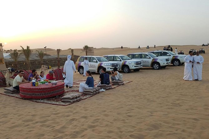 """Welcome to the luxurious-camping experience with """"ROYAL ADVENTURE Camp"""" in the Arab desert to enjoy a magic and memorable evening in the golden desert dune bashing by a comfortable 4×4 Land Cruiser where u can be welcome with Arabic Coffee and dates ,you will get a complimentary snacks and drinks ,you also try an Arabic henna painting artist and get the opportunity to have souvenir photos in Arabic dress .<br><br>You can also ride camel or going by sand-board through sands.<br><br>Enjoy the VIP and food will serve onto private table with private area ,and complimentary Drinks and Desert<br><br>While you try the authentic (Sheesha) you can watch an exceptional live show of Arabic belly dancer and other shows of Tanoura dance at the same time try our delicious starter and BBQ buffet dinner with soft drinks and Arabic coffee and tea.<br><br>Finish your day by the amazing sunset view."""