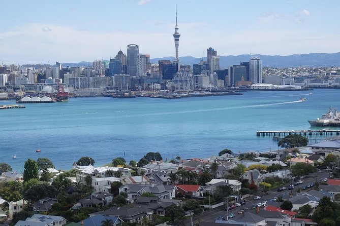 Take in the top attractions of New Zealand's largest city on this full-day scenic tour of Auckland. Drive through the City to Tamaki Drive by air-conditioned 12-seater Mercedes with a guide, discover sites of interest including Devonport, Mission Bay and gaze over the coastal scenery from Achilles Point. Travel to the top of 2 of Auckland's volcanoes for stunning 360 degree views; North Head, a volcano with the most commanding, spectacular views over the City, inner harbour and the Hauraki Gulf, and also see Auckland historic Mt. Eden, the highest volcano on the isthmus. Admire native birdlife at Muriwai Beach, the spectacular rugged coastline with black sand beaches and sip fine wines along the Kumeu Wine Trail. Visit the Auckland Domain, home to the Auckland Museum and visit the 2 stunning Wintergardens and Fernery. Enjoy our historic lunch stop in Riverhead. Marvel as we journey into the lush countryside.This 8-hour tour includes round-trip travel from your Auckland accommodation