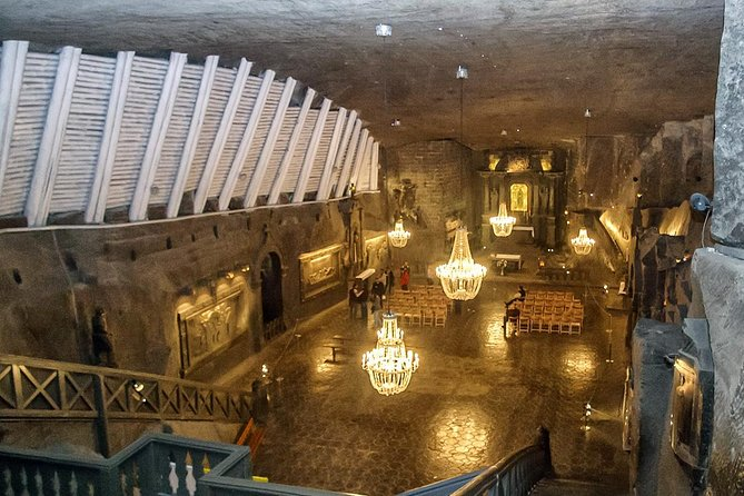 Explore the Wieliczka Salt Mine on a half-day tour from Kraków. Descend underground, hear its history, and walk through the many tunnels and chambers of the mine. See an underground lake and a church with carvings, monuments, and altars made out of salt.