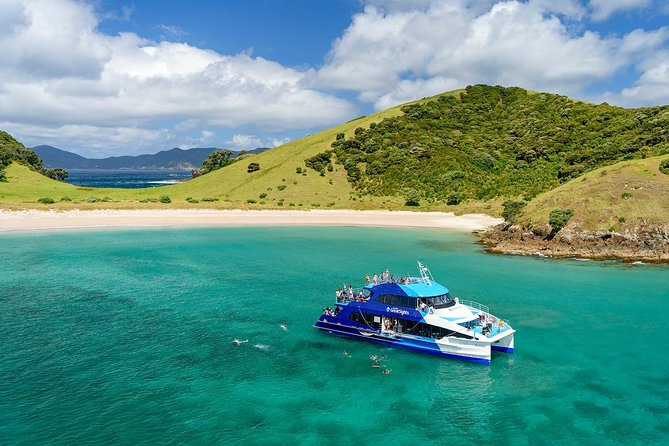 Enjoy a Bay of Islands cruise on the region's only authentic Cream Trip; a 100-year-old tradition of delivering mail and supplies to island residents. <br>Climb aboard a multi-level catamaran and venture out to sea with a knowledgeable crew to inform you along the way. See idyllic bays, Marsden Cross, local homes and natural landmarks like the Hole in the Rock at Cape Brett. Cruising through some 144 islands, be sure to watch out for whales, seals and other marine wildlife. Experience a unique local island by taking a walk or relaxing on the beach and climb in the boom net if you're looking for a thrill. The Cream Trip is the perfect cruise for nature lovers, and the most extensive historical cruise in the Bay.<br>