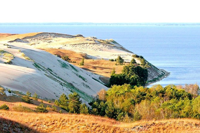 Explore a treasure on the Baltic Sea on this 6-hour day tour to Curonian Spit. Visit Kursiu Nerija, one of greenest areas in the Lithuanian countryside. See the sites of this UNESCO World Heritage-listed area such as Juodkrante, Witch Mountain, Parnidzio Dune, and the Thomas Mann Memorial Museum. Learn all about amber at the Amber Gallery and Museum. Visit the biggest cities in Curonian Spit including Nida, Juodkrante, and Preila.