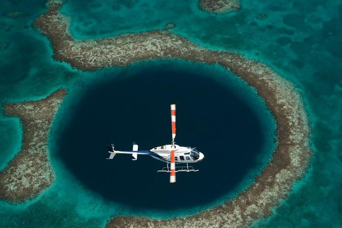 Enjoy magnificent aerial views of the Great Blue Hole of Belize on a private helicopter tour. Your 80-minute scenic flight departs from our base in Belize City, you'll then wind across views of the spectacular Belize Barrier Reef System as well as the Turneffe Atoll island cluster and other natural wonders of the Caribbean. Followed by hovering above the world's largest ocean sinkhole, which boasts UNESCO World Heritage status.Once back on solid ground, enjoy a driving tour of Belize City attractions. Round-trip pickup included to your hotel or cruise ship terminal on board our air-conditioned Astrum Helicopters van.