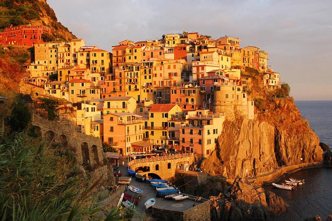 Book this unique boat tour to see the colourful towns of Cinque Terre and their beautiful coastline from the blue waters of the Ligurian sea. Relax at sunset and enjoy a typical Italian aperitivo while you try to spot the dolphins from the boat!