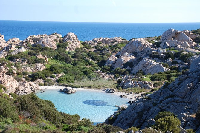 """Book this full-dayexcursion for small groups (max 8 people!) to explore the beautiful islands of La Maddalena and Caprerain Sardinia. <br><br>Your driver will come pick you up from your accommodation with a comfortable minivan and theywill take you to Palau. From there, together with your guide, you'll board a ferry boat to reach the island of La Maddalena. Once on the island you'll have the opportunity to visit the characteristic old town of La Maddalena, a small city full of curious attractions. Followingone of Sardinia'smost famouspanoramic roads, you'll then reach the Island of Caprera, with its breath-taking sea view. A real paradise, withturquoise lagoons, deserted islands and the most heavenly beaches, immersed in the beautiful """"Parco nazionale dell'Arcipelago di La Maddalena"""". If you want, you can also request to stop at one of the stunning beaches of the islands... <br><br>Just one tip: don't forget to take your camera with you!"""