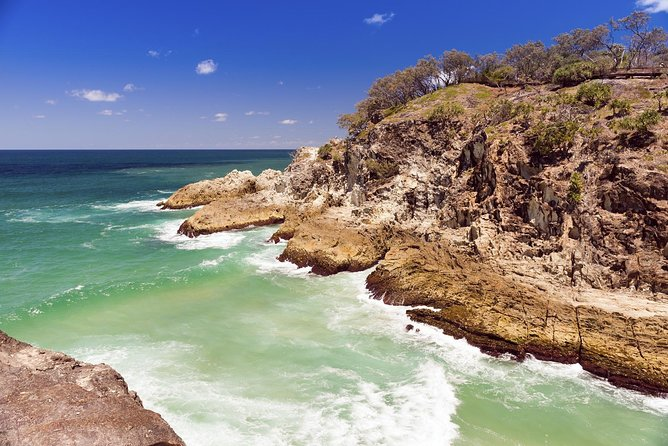 Discover the beaches and wildlife of Queensland on a guided day trip to North Stradbroke Island. Enjoy a luxury catamaran cruise across Moreton Bay (about 50 minutes) through the Islands with a chance to spot dolphins from the viewing deck. Famous for its natural attractions, including a resident population of kangaroos and koalas, the island also offers walking tracks, marine wildlife viewing, and a relaxed atmosphere in small townships. Swim in the Pacific Ocean, take a short guided hike, and have free time to explore. This tour operates with a maximum of 21 people, ensuring you'll enjoy a small-group experience with your expert guide. Lunch is included. Highlights include:<br>* Comfortable ferry ride across Moreton Bay<br>* Stops at Amity Point, Point Lookout, Cylinder Beach, North Gorge, and Myora Springs<br>* Enjoy lunch with fantastic views of the Pacific Ocean<br>* Best opportunity to view koala, kangaroo, dolphins, turtles and a variety of bird life.<br>* Free time at Cylinder Beach. Swim?