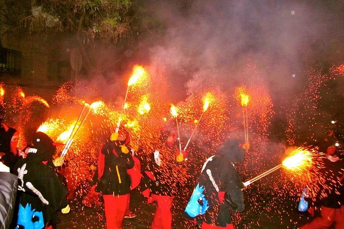 See a different side of Catalonia on an evening trip from Barcelona to a traditional 'correfoc' (fire-running) festival in a local village! Watch villagers dressed as devils ward off evil spirits by dancing to music and turning the village into a fiery cauldron of light and fireworks. It is a unique, real, and unforgettable experience! Dance with the devils between the crowds or just watch the spectacle of fire. Numbers are limited to 14 on this small-group tour, ensuring you'll enjoy this traditional festival with personalized attention from your guide.