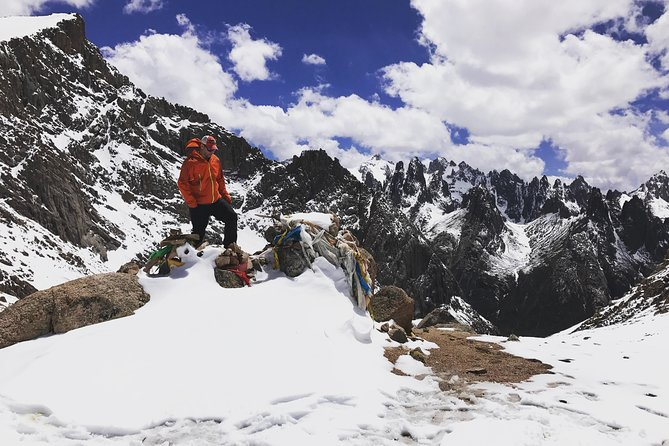 Trek past fields of Edelweiss and yaks grazing near turquoise glacial lakes and discover the dramatic shark tooth peaks of Nyenbo Yurtse. This the home to Tibetan nomads who live at the base of a mountain that hovers at a lofty 5369 meters/17,615 feet.<br><br>And getting there is half the fun! Along the way to Nyenbo Yurtse you will get to walk through the mud-daubed alleys of Labrang Monastery and see the untamed grasslands and the nomads who worship there.<br><br>This particular itinerary offers 3 days of trekking with horses carrying your backpacks every day so you only need to carry a light daypack on the trek.