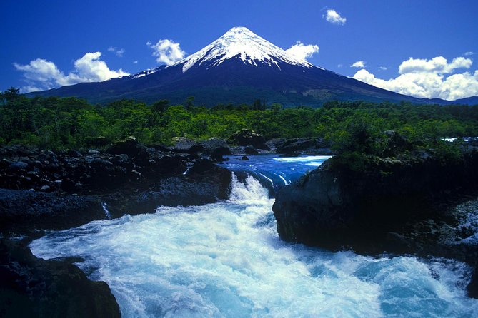 The Lake District possesses many mind-blowing sights, and one is the Osorno Volcano painted in the back of the Llanquihue Lake, with occasional clouds towering it; a true postcard image. <br><br>See a lake of glacial origin and an active volcano with its cone shaped perfectly. <br><br>Enjoy the beautifil views of Petrohue River Falls. <br><br>Climb one of the most famous volcanoes in Chile.