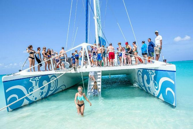 """This 3 hour luxurious 65-ft. """"Kitty Katt"""" family catamaran cruise will take you to one of Turks and Caicos' most stunning coral reefs, where you'll snorkel and swim with brilliantly-colored fish and other surprising tropical marine life. <br><br>Then the """"Kitty Katt"""" sails off to a pristine deserted cay where beachcombers can hunt for seashell and sand dollar keepsakes, take in the Caribbean breeze and warm sun on the beach, or fly down the """"Kitty Katt's"""" 8-ft. tube slide."""