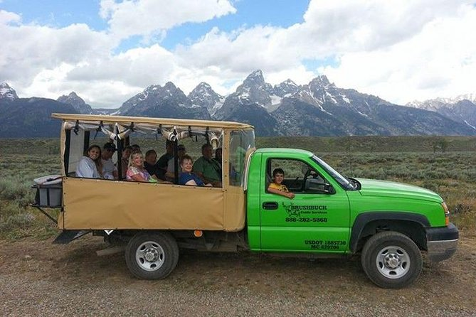 Explore Grand Teton National Park in search of wildlife on this exhilarating tour by open-air safari-style vehicle in the summer (June 15 - August 31). At dawn or dusk, you'll get the best chances of sighting bears, wolves, elk, moose, eagles and more on your safari adventure. Your naturalist guide will ensure your enjoyment and safety, teach you all about the park's geology and ecology, and stop along the way to let you take photos of your gorgeous surroundings. <br><br>This small-group tour is limited to 12 people, ensuring a more personalized experience.<br>*Tours departing from September-May will take place in a heated and enclosed 10 passenger vehicle and be limited to 10 guests total.*