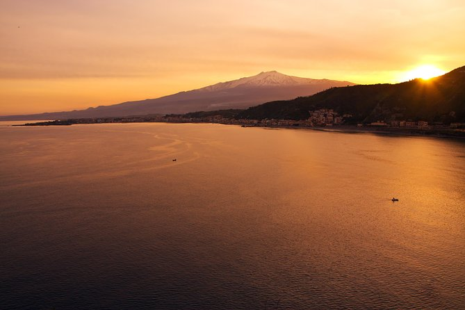 Watch the sun set from the summit of Mount Etna on an evening tour from Taormina! After exploring the area around the fiery volcano at approximately 9,843 feet (3,000 meters) on a walking tour, gaze out over the Sicilian hills as the sun goes down. Before returning to Taormina, stop at a traditional restaurant in the volcano's foothills for dinner and drinks at your own expense.