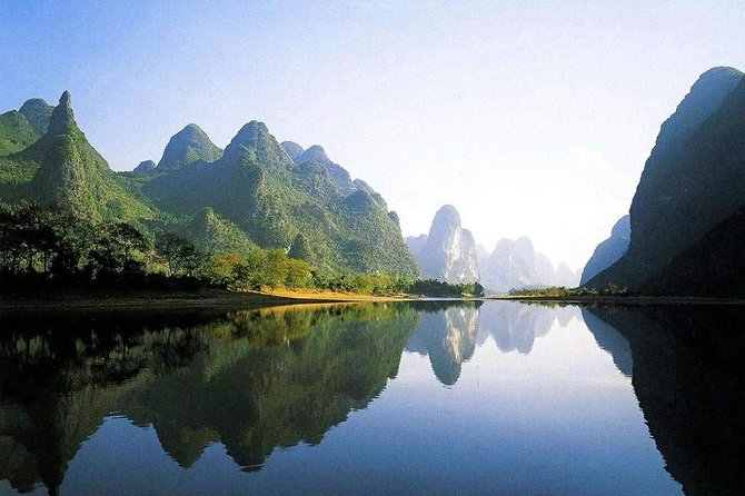 This Li River Cruise will take you from Guilin to Yangshuo. Soak up serene atmosphere and enjoy picturesque scenery along the way. Hotel pickup from Guilin is included, and you have the option of ending the tour in Yangshuo or returning to Guilin.