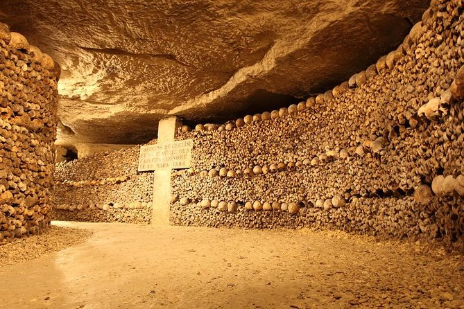 Explore the mysterious underground world of the Catacombs in Paris on this 1.5-hour tour. Meet your guide and head underground to enjoy a narrated tour of the tombs. Hear the history behind this labyrinth of tunnels, which contains the bones of more than six million people.