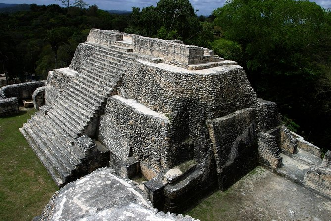 Travel through time to the mysterious world of the ancient Maya at Caracol, the largest Mayan site in Belize! Located deep within the Chiquibul Forest Reserve and nestled amid high-canopy jungle, the archaeological complex includes five plazas, an astronomic observatory and thousands of buildings. You'll learn about Caracol's agricultural practices, sacred rituals and their historic defeat of Tikal as you tour the site with your knowledgeable guide. This day trip from San Ignacio includes round-trip hotel transport by minivan or SUV.
