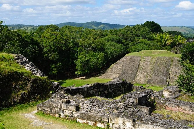 Travel back in time and experience what life was like in the city of Xunantunich, one of Belize's most popular Mayan sites. This tour from San Ignacio takes you to San Jose Succotz, a Maya-Mestizo village located close to the Western Border and delivers you on an old-fashioned, hand-cranked ferryboat to the magnificent ruins deep in the Belizean rainforest. Admire astronomical carvings at El Castillo (The Castle) and sweeping views of the Belize River Valley and neighboring Melchor de Mencos, Guatemala once you've climbed the steep pyramid steps to the top! Hotel pickup and drop-off within San Ignacio Town are included.