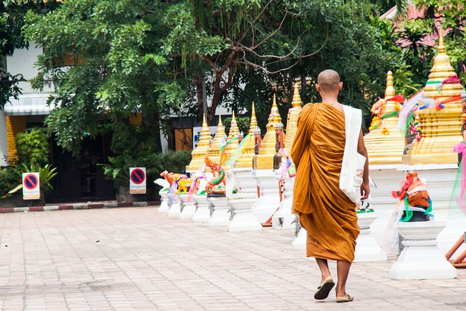 Gain insight into the spiritual life of Thai Buddhists in Chiang Mai on this early morning tour with a knowledgeable private guide. Join devotees who provide morning alms to local monks, then climb the staircase to the golden pagodas of Wat Phra That Doi Suthep, followed by a private blessing ceremony at the monastery of Wat Umong. Finish with a delicious northern-style noodle dish, complete with coconut milk and spices. Hotel pickup and drop-off by air-conditioned vehicle are included in your 5-hour private tour.
