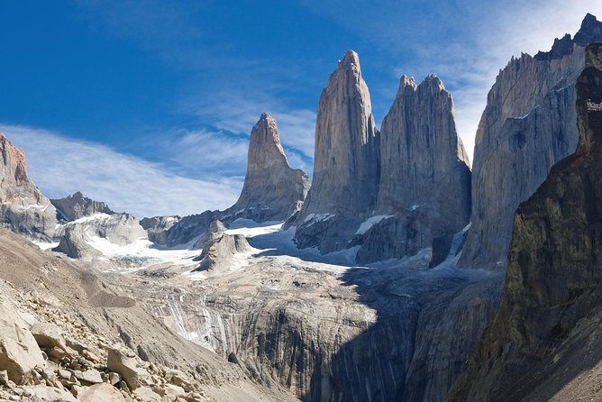 Rise early and hike to the iconic Paine Towers on this full-day tour from Puerto Natales. Explore the diverse landscapes of Torres del Paine National Park during a moderately difficult trek across Ascencio Valley, up and down switchbacks, over streams and through a peaceful lenga forest. Ascend a great moraine and at the top of these barren slopes, marvel at the three spikes of granite soaring into the sky and a brilliant glacial lake below. This small-group tour is limited to six people, ensuring personalized attention from an expert guide for a memorable experience.