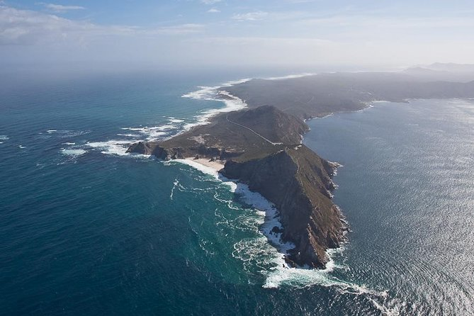 Pick up from hotels in central areas<br><br>Small air conditioned vehicles with accredited professional driver guides<br><br>Scenic views or mountains and beaches from the coastal road along the Atlantic Ocean, through Camps Bay and Clifton to Hout Bay.<br><br>12 Apostles Peaks<br><br>Optional boat trip to Seal Island (own account +/- R80), or shop for souvenirs, or enjoy refreshments (own account)<br><br>Chapman's Peak (if open)<br><br>Cape of Good Hope Nature Reserve and Cape Point with option to take the funicular (own account +/- R 80) to the lighthouse, or enjoy the walk<br><br>Visit to Boulders Beach to see the Penguins (included) or shop for souvenirs, or enjoy refreshments (own account)<br><br>Drive through Simon's Town and see the Indian Ocean.<br><br>Visit Kirstenbosch Botanical Gardens (own account +/- R70) before returning to your hotel