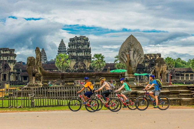 """On this tour, you will explore the less-traveled roads of Angkor along small forested trails. In addition to experiencing beautiful, unseen nature, you will also be able to discover the sacred places of Angkor, such as the famous temples of Angkor Wat, Bayon, the South Gate, and Ta Prohm, which is well-known as the """"jungle temple"""". In addition, you will visit well-preserved traditional villages and interact with local people who live around the temples. This bike tour will take you deep into Khmer history and culture with the assistance of your informative tour guide."""