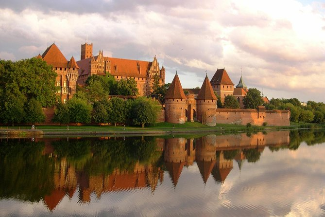 "Enjoy a 6-hour tour from Gdansk to Malbork Castle, the largest red brick Gothic castle in the world. Admire the beautiful architecture, learn about the history of the castle, and admire the ""History of Amber"" exhibition in the castle's cellars.  <br><br>Highlights: <br> • Visit Malbork Castle, one of Poland's celebrated UNESCO World Heritage Sites <br> • Hear about monastic life in the Middle Ages, and learn about the Baltic Crusades <br> • Admire the gorgeous jewelry in the Amber Museum located inside the castle <br> • Learn about the long history of the Gothic castle <br> • Get picked up and dropped off at your hotel in Gdansk, Gdynia, Sopot"