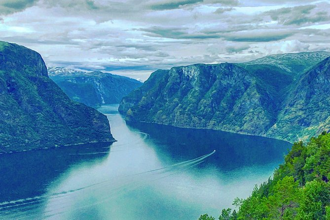 On this amazing sightseeing tour from Flåm on a minivan with a private driver-guide, you will explore the natural wonders of the Norwgian Fjord landscape are - inscribed into the UNESCO World Heritage list.<br><br>You will first stop at Stalheim hotel to enjoy the view of the stunning Nærøydalen valley, then take a drive down the Stalheimskleiva hairpin turn road and walk up close to the Stalheimsfossen waterfall, before coming to the charming village of Gudvangen.<br><br>In Gudvangen you can to witness the gorgeous Nærøyfjord - one of the two UNESCO World Heritage fjords. Here you can also visit a real modern day Viking Town (optional).<br><br>After Gudvangen, on to the famous Stegastein viewpoint above the Aurlandsfjord. In Aurland village, you can alsovisit the local Glass workshop (optional).<br><br>Duration of the tour: 4-4.5 hours. You may choose to either visit the Viking town or the Aurland Glass workshop, or none of the two – and have more time to soak up the natural beauty of the western fjords.