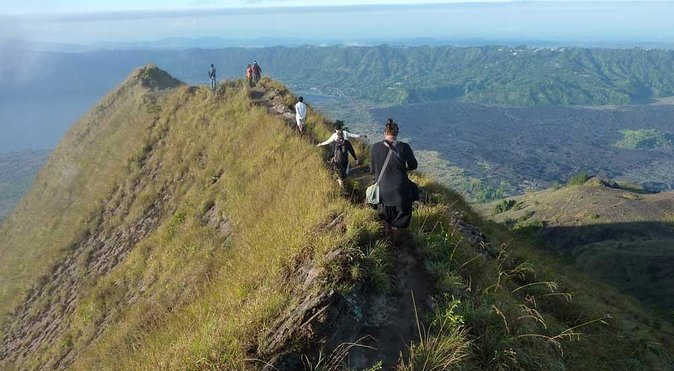 Hike your way up, then stand atop, the ancient Mount Batur volcano and watch the sun come up over the sea. Feel the adrenaline kicks in as you see the sky turn from black to inky blue, from pink to orange, revealing the expanse of the volcanic valley.