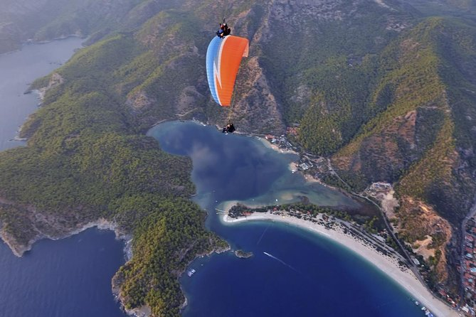Fly like a bird above the spectacular Blue Lagoon at Ölüdeniz on this epic tandem paragliding experience from Fethiye. Feel the excitement build on route to Babadağ Mountain, the peak that towers over the aquamarine lagoon and Ölüdeniz beach. Then, harness up with a professional pilot for a thrilling paragliding ride. Soar into the sky, ride the warm breezes and marvel at the aerial views as your pilot controls your speed and direction before a gentle touchdown on the beach. Simply exhilarating, and no experience required.