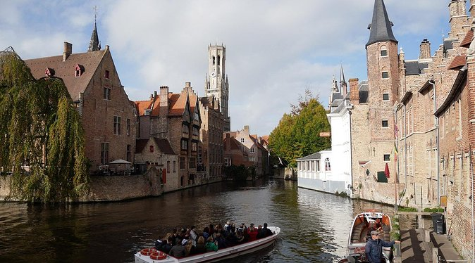 """Visit Ghent and Bruges with a professional driver and a tour guide. <br><br>Our tour is customizable. Here you can find a general programme of your visit: <br><br>Starting of the tour from your location to Bruges, the famous """"Venise of the north """" Unesco world heritage. Discover the canals and beautiful gothic buildings with the explanations of your guide who will bring you to the most interesting places of the City center as the Basilica of the Holly blood of Jesus, the Belfrey tower, the Minnewater lake, our Lady Church, Sint Janshospital with it's beautiful Memling museum and/or the Groeninge museum. Enjoy and optional boat trip. Free time for lunch. After lunch, continuation to Ghent and it's marvelous Altarpiece in the Cathedral. Enjoy the canals and guild houses of the City center with an optional boat trip. Don't miss the Castle of Counts of Flanders! After the visit, the guide and the driver will drop you off at your hotel or elsewhere in Brussels."""