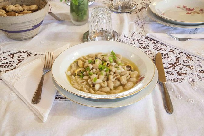 Local market visit and dining experience at a local's home in Brindisi, Brindisi, ITALIA