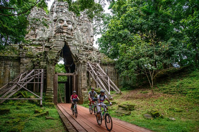 Bicycle along quiet trails in the Cambodian countryside and explore the breathtaking temples of Angkor on a full-day excursion with a local guide. This bike tour inside UNESCO-listed Angkor Archaeological Park includes stops at major temples such as Angkor Wat, Ta Prohm and Bayon Temple as well as some less-visited sites along the way. Finish with an enjoyable ride through villages back to Siem Reap. This small-group tour, limited to 14 participants, includes a delicious lunch and refreshments.