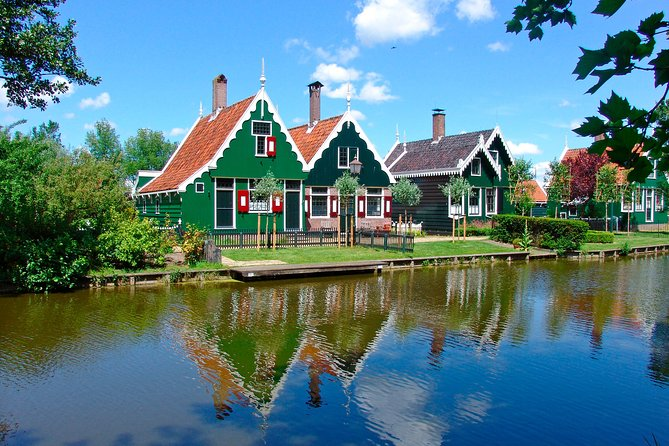 From the churning windmills in the Zaanse Schans to the cheese weighing house in Edam, this tour highlights everything that is typical Dutch. See the beautiful landscapes of the province of North Holland and explore the traditional fishing village of Volendam. Learn about clog making in the wooden shoe shop and try some tasteful cheese in one of the Dutch cheese farms. Zaanse Schans. This outdoor preserved area is situated on the banks of the River Zaan and is home to the original 18th and 19th century architecture, including several still functioning windmills and wooden houses. From there we continue to the beautiful village of Edam, also commonly referred to as the pearl of the former Zuiderzee. Edam's old streets and quiet canals are lined by beautiful 17th century buildings, including the leaning Carillon tower, the Big Church, and former town hall. Volendam; this typical fishing village with its bustling harbour has been a major tourist attraction since early 1875.