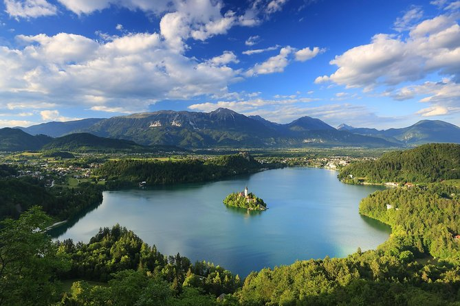 A trip to Bled must be a part of any visit to Slovenia. Take our half-day tour and visit Lake Bled, the charming Alpine resort at the very edge of the Julian Alps. Explore Bled Castle, perched high above the Lake Bled's tranquil waters and admire the views of Lake Bled from several viewpoints at the castle. Ride a traditional 'pletna' boat to Bled Island, where you can visit the church or try local sweet treats at the cafe. Enjoy a perfect day sipping coffee and eating »Kremšnita«, the traditional Bled custard cream cake, at the lakeside.  <br><br>On our tour to Lake Bled we treat you with a traditional pletna boat ride to Bled island, a top attraction in Slovenia. Pletna boats are unique to Lake Bled and operated by a single rower with two long oars. Following the boat ride, you get some time to explore the little island and enjoy the stunning views of the surrounding area. Optionally, you can enter the Church of the Assumption and even ring the wishing bell, which has been ringing over Lake Bled since 1534.  <br><br>Our guide will also take you to visit Bled Castle and the castle museum, which gives you an insight into the history of the entire area. We will show you some of the best viewpoints form where you will be able to admire magnificent views over Lake Bled and Bled Island and take beautiful photos. Bled castle is more than a thousand<br>years old, and one of the most spectacular castles in Slovenia. On the shore of Lake Bled it is possible to take a short walk along Lake Bled and watch the majestic swans and playful ducks swimming on the lake. Or you can relax and take a break in one of the coffee shops - where you need to try kremšnita, the traditional Bled custard cream cake.  <br>