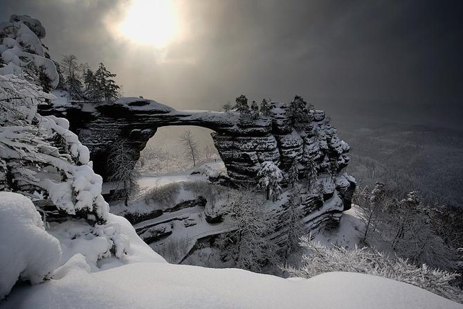 Visit the two highlights of the Bohemia and Saxon Switzerland National park. Our day long guided tour will take you into the heart of the Czech Bohemia and German Saxon Switzerland national park (The Elbe River Canyon Region).<br>Take a trip into a winter wonderland on this 8-hour guided tour from Dresden. In a small group of no more than six, travel into the heart of Central Europe and visit the two highlights of the Bohemia and Saxon Switzerland National Park. Begin on the German side of the border, where the Bastei Bridge connects rocks formation and walk through the forest to Pravcicka Gate, the Europe's largest sandstone archway, to the Czech side.