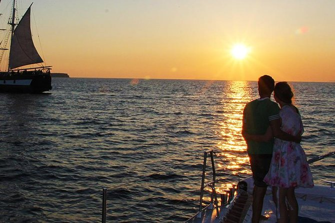 Enjoy a perfect sailing Sunset tour in the magnificent island of Santorini on board our catamaran. The catamaran sails to the most amazing sights of Santorini like the Hot Springs area, Caldera, Red & White Beaches area. Swim and snorkel at the crystal deep blue water of Santorini. A delicious barbecue meal is freshly prepared on board. Complimentary drinks such as local white wine, soft drinks, water and juice are served throughout the trip. Sailing between Oia village and Thirassia Island and waiting for the breathtaking sunset.