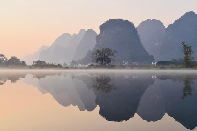 Your visit to Yangshuo won't be completed without Yulong River. Hiking along the most beautiful parts of this river is the best way to feel and touch her charm. During the hiking, you will come across some stone arch bridges and ancient villages with featured houses in. Seasonal crops and orchards can be seen and learned all the way along.