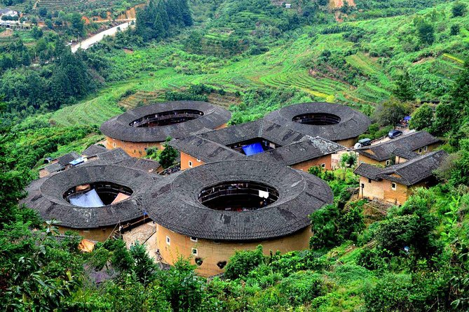 """Among the more intriguing pieces of history in Fujian are the tulou -- large, round, rammed-earth buildings dating back centuries.46 Fujian Tulou sites including Chuxi tulou cluster, Tianluokeng tulou cluster, Hekeng tulou cluster, Gaobei tulou cluster, Dadi tulou cluster, Hongkeng tulou cluster, Yangxian lou, Huiyuan lou, Zhengfu lou and Hegui lou have been inscribed in 2008 by UNESCO as World Heritage Site,""""as exceptional examples of a building tradition and function exemplifying a particular type of communal living and defensive organization, and, in terms of their harmonious relationship with their environment"""". Today you will vist Tianluokeng tulou cluster and Dapinglou(a well-preserved authentic Tulou that houses more than 200 peoplewho still keep their original lifestyle)."""