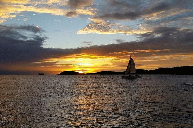 **A Beautiful Sunset Sail** <br>What better way to experience the Caribbean Sunset than aboard 'The VI Cat' for a beautiful 1.5 hour sunset cruise with appetizers and open bar around Charlotte Amalie Harbor.<br><br>Included in price: Fruit & vegetable platters, pita and hummus, meat and cheese platter, chips and salsa, water, a variety of non-alcoholic beverages, alcoholic cocktails, wine and beer.