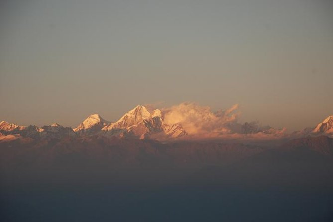 Enjoy the beautiful view and sunrise from the best viewpoint of the valley on this Nagarkot Sunrise View one day package which also includes hike towards one of the UNESCO World Heritage Sites of Nepal, Changunarayan. This Nagarkot Sunrise View and Day Hike to Changunarayan will excite you early in the morning with a mesmerizing view of many glorious peaks of Nepal like Mt. Annapurna, Ganesh Himal, Mt. Everest, and 8 out of 13 mountain ranges that shines in early sunrise including panoramic view of the valley and Shivpuri National Park. After such a fantastic start early in the morning, hike down to Changunarayan with beautiful nature walk amidst the forest of pine and terraced farms crossing typical and local villages of Tamang and Newar community. At Changunarayan, you will be impressed by the stone and wood carvings and sculptures of Hindu and Tantric deities which will show you the rich and old heritage of Nepal.