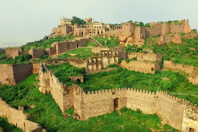 Your exclusive, skip the line full 8 hrs tour starts with pickup from your place of stay by the licensed, historian / guide to start exploring one of the world's 8 kms circumference massive fort: GOLCONDA followed by the Necropolis of their Qutub Shahi dynasty rulers, buried next door. Both are 12 kms away from city centre. You have an option to climb 365 steps one way or linger around the ramparts of the palatial buildings. Experience the ecosystem carried all the way to 400 fts of Bardari !!!. The hot lunch with ethnic Hyderabadi dishes will be provided. Further visit the old city area for an enchanting walk of Bridal ware, Bangles, Spices Bazaars around Charminar, the landmark of Hyderabad, theLaad Bazarstreet get your hands painted with local Mehndi and Antiques culture.. See theChowmahalla Palace,Latter theMecca Mosque(10000 prayers at once). Enjoy the sip of Special Irani Tea with Nizam Biscuits.