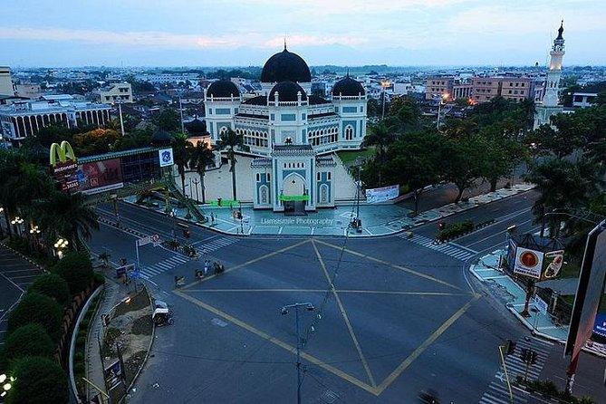 "Visit the Royal Palace of Sultan Deli, known as Maimoon Palace, built in 1888. See the grand mosque ""Mesjid Raya"", built in 1906 and the largest in town. We'll also visit Asam Kumbang Farm, where you will observe crocodiles of different sizes and ages. Browse for antiques at Kesawan Street in the old colonial part of the town. You will feel the Dutch colonial architectural touch in buildings like the post office and Medan City Hall."