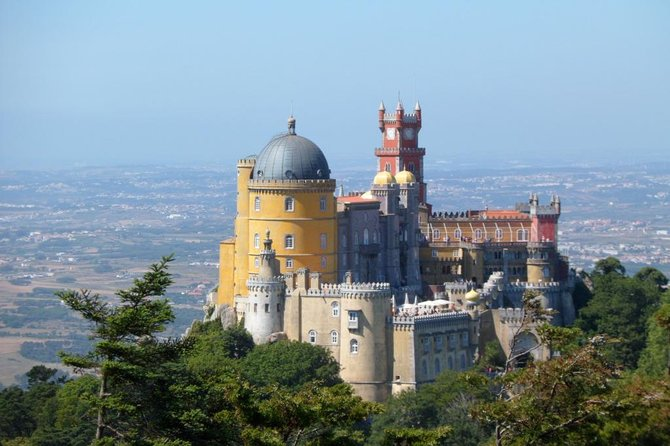 Discover Sintra, former Summer Residence of the Portuguese Kings, classified as UNESCO World Heritage site, just outside Lisbon, on our semi-private tour. Guided visit to Pena Palace (ticket not included) and free time at the historical center.<br><br>After lunch, the tour continues to the western most point of Europe (Cabo da Roca), followed by a visit to Cascais Fisherman Village. The tour will also pass through Estoril, on the coast.