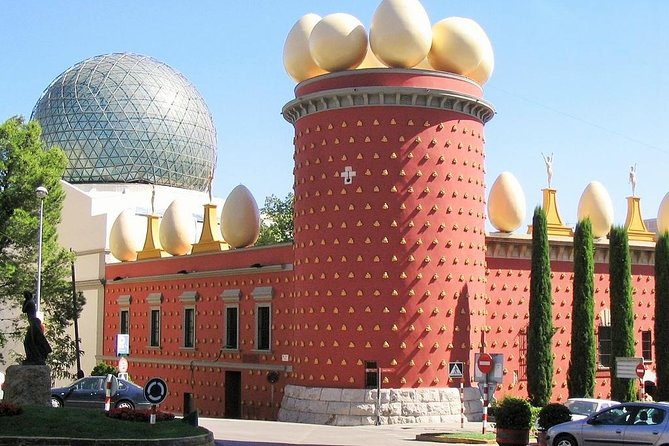 On this full day tour about the work and the live of Salvador Dalí, you will have a guided visit of about 2 hours to the Theatre-Museum Dalí in Figueres by an expert guide who will help you to discover all the secrets of the Dalí works. After this visit we will drive to the village of Cadaqués, one of the most beautiful villages of the Costa Brava and so often reproduced in Dalí's paintings. In Cadaqués you will have a guided visit to this village known as The Pearl of the Mediterranian and also you will have free time to have lunch there. After lunch you will have a walk around the breathtaking scenery of Creus Cape's Natural Park. Furthermore you are going to walk around Port Lligat, the small bay where Dalí lived all his life. Finally, we will stop on the way to Girona in a celler where you will enjoy a tasting of wine (D.O.Empordà), olive oil and other delightful products of this area.<br>Enjoy our small group tours up to 6 people with a Modern Van with airconditioning.