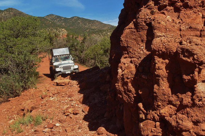 """This interpretive 3-hour jeep tour departs from Canon City and meanders through bright red towering spires and monoliths sculpted by the erosion of the fountain formation. Your geological tour through time includes a short walk out to """"Overlook Arch"""" and a up-close look at dinosaur footprints left over 107 million years ago. You will see where paleontologists have been removing dinosaur remains for over 140 years from one of the most famous digs in history along with ancient Indianpetroglyphs. <br><br>This scenic tour is just one of the amazing locations we visit from our office in Cañon City. If this tour doesn't meet your needs, we most likely have one that does. We offer tours and packages from 3 hours to all day. Be sure to see our other listings for more options."""
